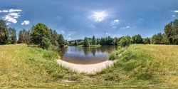 seamless spherical hdri panorama 360 degrees angle view on grass coast of small lake or river in sunny summer day and windy weather with beautiful clouds in equirectangular projection, VR content