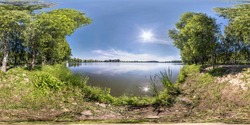 seamless spherical hdri panorama 360 degrees angle view on grass coast of small lake or river in sunny summer day with beautiful clouds in blue sky in equirectangular projection, VR content