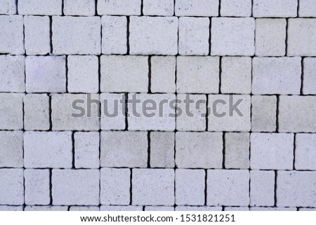 Seamless texture of grey paving tile cobbles background