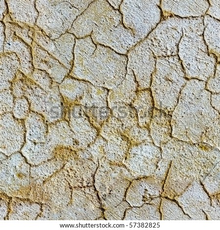 Seamless texture of plaster on a wall with cracks