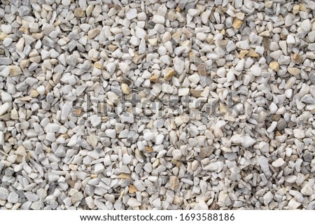 Photo of  Seamless texture of white stones or gravel. Road gravel, crushed stone. Gravel texture. Crack stones at a construction site.