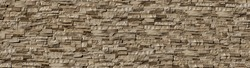 Seamless texture wall stone sandstone with shadows and deep texture.  background of clinker tiles or bricks on the wall in the form of wild stone. Panorama beige and brown tones with shadows and deep