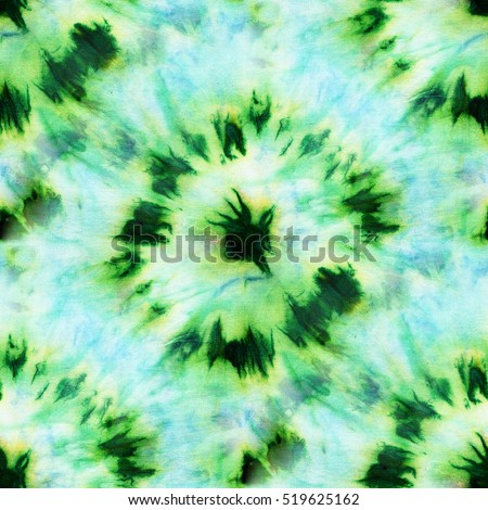 Seamless tie-dye pattern of green and blue color on white silk. Hand painting fabrics - nodular batik. Shibori dyeing
