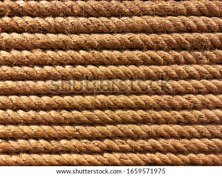 Photo of  seamless tied rope in a row in parallel line background in closeup full frame.