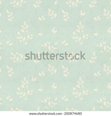 Seamless vintage wallpaper pattern on paper texture. Subtle background.