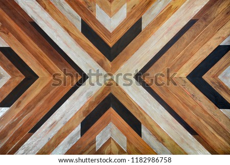 seamless yellow, black, white and dark brown color lumber in arrows or chevron pattern to the center for texture background. top view #1182986758