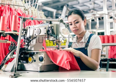 Shutterstock Seamstress or worker in Asian textile factory sewing with  industrial sewing machine