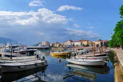 Seaport and yachts in the old town of Budva in sunny day, Montenegro