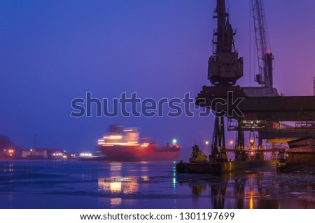 SEAPORT AT DAWN - The cargo ship maneuvers to transhipment wharf in Swinoujscie