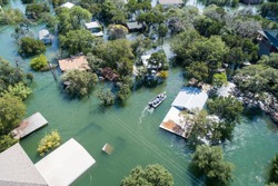 Search and rescue out after natural disaster major flooding leaves central Texas underwater and entire community and neighborhood flooded. Homes and houses flooded, home insurance needed