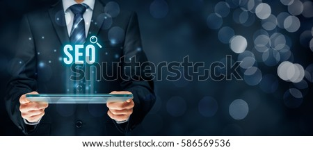 Search engine optimization - SEO concept. Businessman or programmer is focused to improve SEO and web traffic.