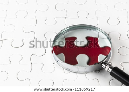 Search for missing puzzle pieces with a magnifying glass