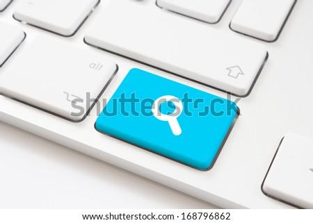Search key on a white keyboard