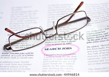 Searching job with newspaper and glasses