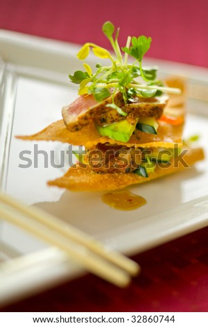 Seared japanese-style tuna with avocado, sprouts, cucumber and a sweet sauce.