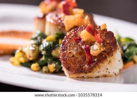 Seared Scallops on bed of greens