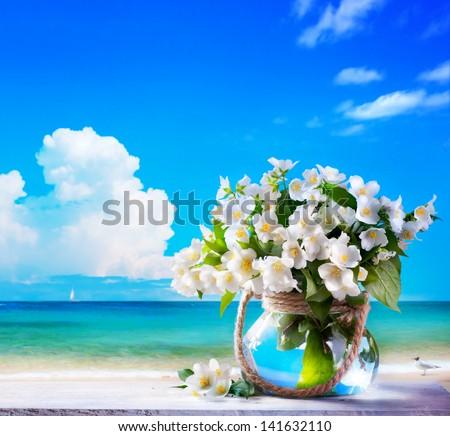 seascape and jasmine flowers