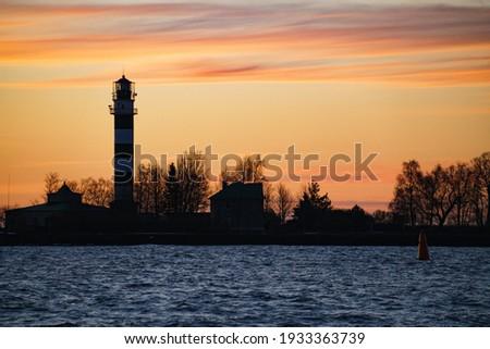 Seascape at sunset. Lighthouse on the coast. Photo stock ©
