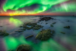 seascape Aurora Borealis. soft focus due to long expose.
