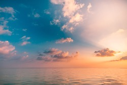 Seascape beach and colorful dream summer sky. Panoramic beach landscape. Empty ocean view, horizon seascape. Orange and golden sunset sky, sun rays, calmness, tranquil relaxing sunlight, summer mood