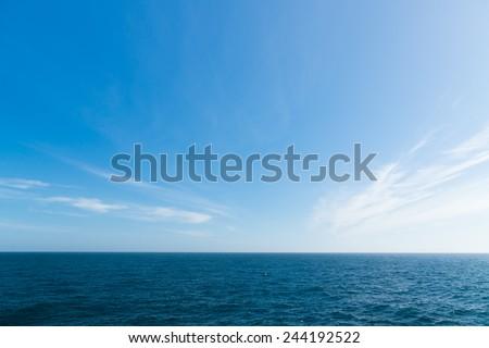 Seascape. Blue sky and white cloud. Calm sea. #244192522