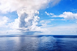 Seascape, blue sky, clouds and sea in the tropical waters of the Pacific Ocean.