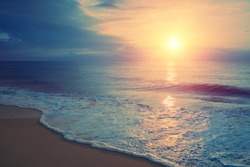 Seascape in early morning, sunrise over sea. Calm sea with beautiful sky. Nature landscape. Sandy beach in summer