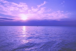 Seascape in early morning, sunrise over the sea. Seashore during sunrise