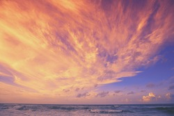 Seascape in the evening. Sunset over the sea with beautiful dramatic blazing sky