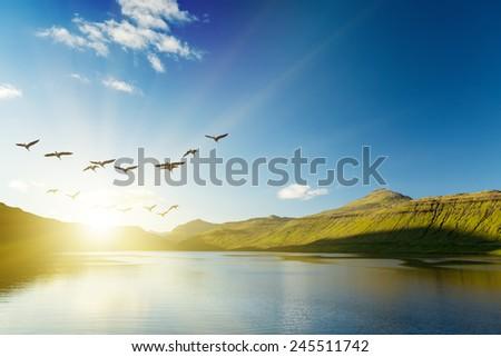 Seascape, mountains on the horizon. The Faroe Islands. The sunrise.