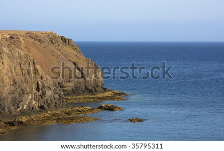 Seascape of a cable in the sea of Lanzarot Island