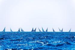 Seascape of luxury regatta in Saint-Tropez, France. Open sea sailing race regatta in Mediterranean sea.Regatta background with place for text.Vacation concept. Active lifestyle.Nautical tourism design