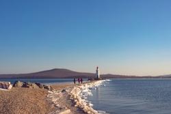 Seascape overlooking The Tokarev lighthouse against the blue sky. Vladivostok, Russia