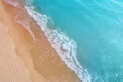 Seascape, sandy beach, sand and water, top diagonal view, abstract nature landscape background