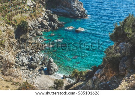Seascape scenery. Rocks and beautiful natural clear lagoon at Mediterranean sea coast of Turkey, near Gazipasa town #585101626