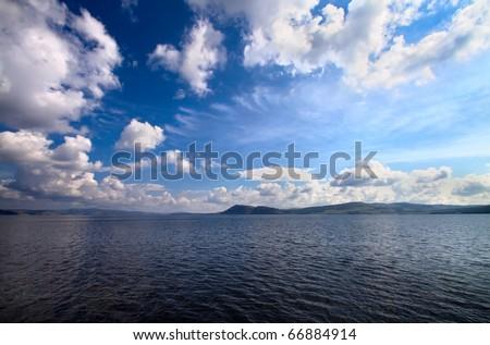 seascape. seacoast and fantastic blue cloudy sky