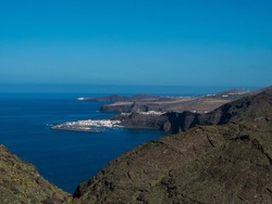 Seascape view of Puerto de las Nieves, traditional fishing village port with cliffs and rocky atlantic coast in the north west of Gran Canaria, Canary Islands, Spain.