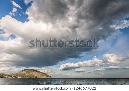 Seascape with beautiful cloudy sky and Ayu-Dag mountain in Crimea