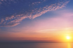 Seascape with beautiful sky in the evening. Sunset over the calm sea. View from above.