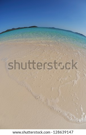 Seascape with beautiful weather, blue sky and clear water. Fish-eye lens.