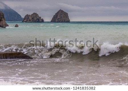 Seascape with foamy waves, Ayu-Dag mountain and Adalary rocks in village Gurzuf