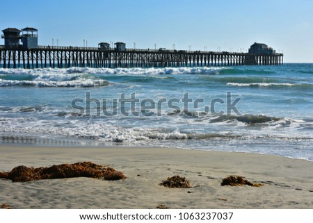 Seascape with panoramic view of Oceanside Pier in San Diego Southern California, one of the longest wooden piers on the West Coast. #1063237037