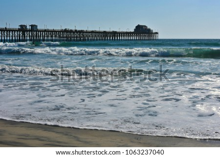 Seascape with panoramic view of Oceanside Pier in San Diego Southern California, one of the longest wooden piers on the West Coast. #1063237040