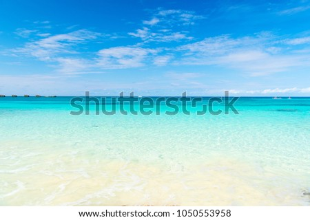 Seascape with transparent water on blue sky horison. Sea beach in Great stirrup cay, Bahamas on sunny day. Summer vacation on caribbean. Wanderlust, travelling, trip. Adventure, discovery, journey.