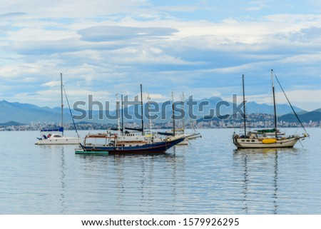 Seascapes with yachts on the calm sea at Santo Antonio de Lisboa, Florianopolis, Brazil #1579926295
