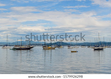 Seascapes with yachts on the calm sea at Santo Antonio de Lisboa, Florianopolis, Brazil #1579926298