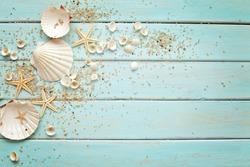 seashells frame on wooden background. nautical border