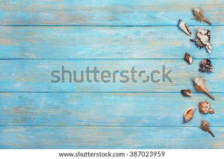 Seashells on wooden background - Shutterstock ID 387023959