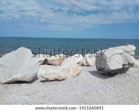 Seashore background, beautiful view with sea and stones #1411660841