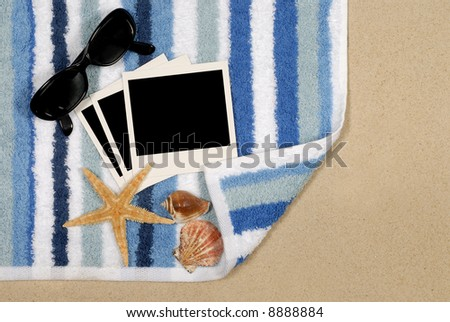 Seashore background with blank instant photo prints, shells, beach towel and starfish